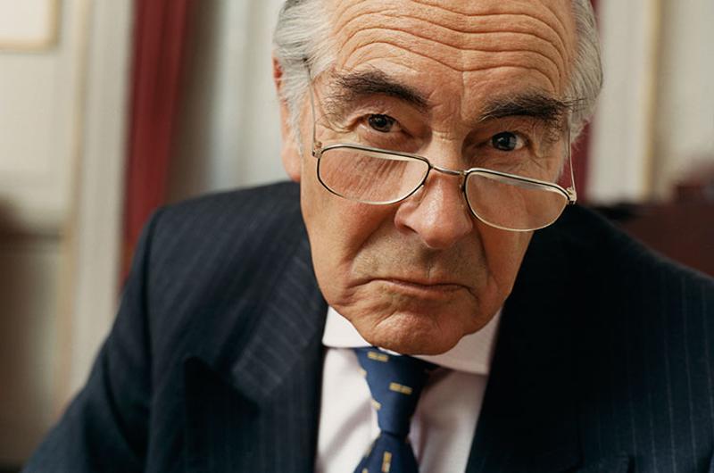 annoyed old businessman