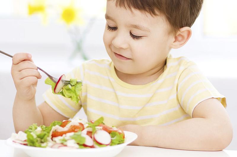 boy eating salad