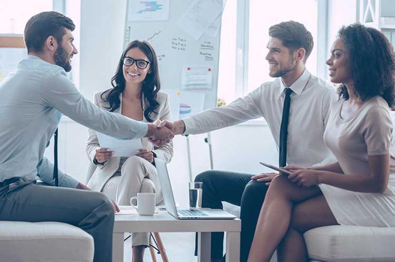 business hand shake group welcome