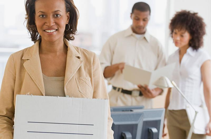 business woman packing box