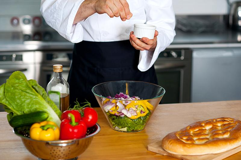 chef salting vegetables display cooking