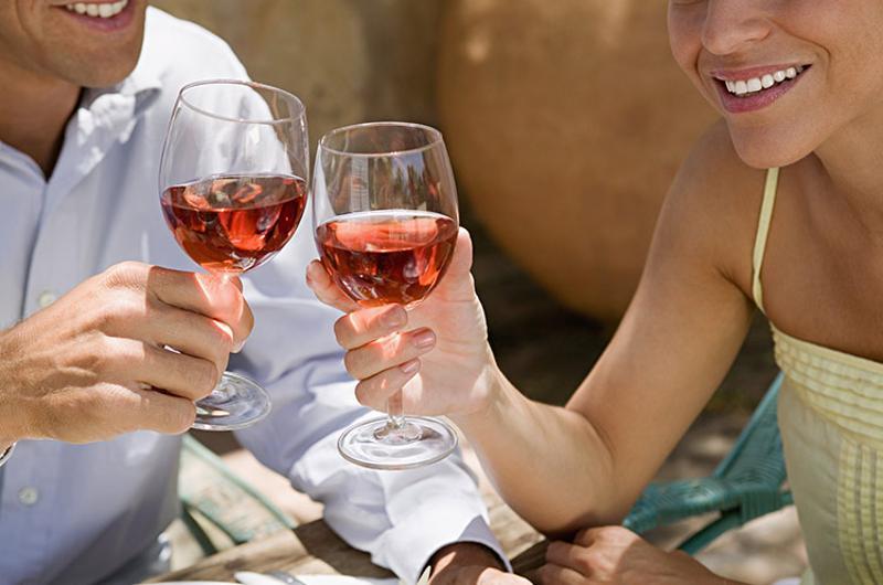 couple cheers wine