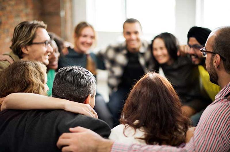 employee huddle hug