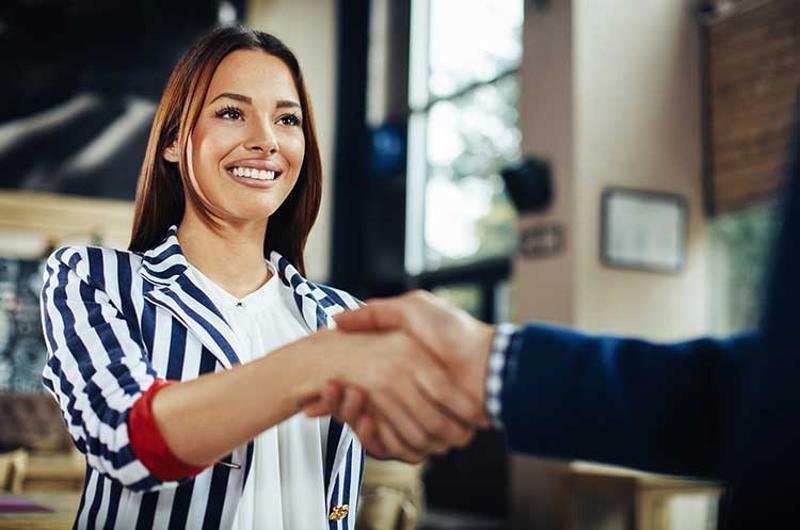 greeter hostess woman handshake