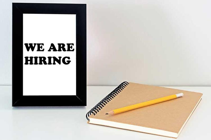 hiring sign notebook