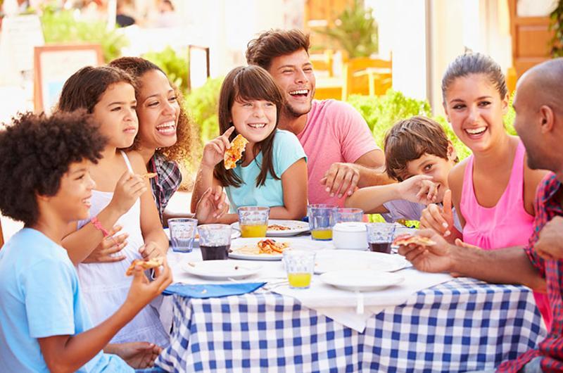 hispanic family eating out