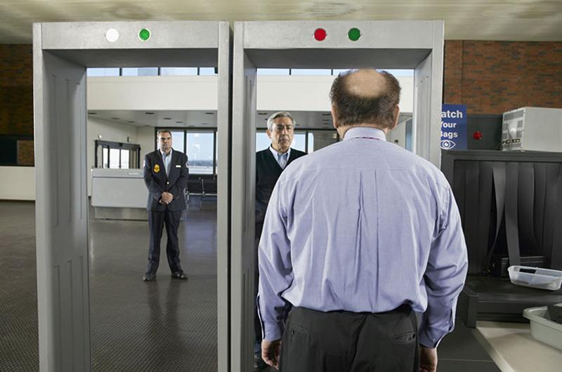man metal detector
