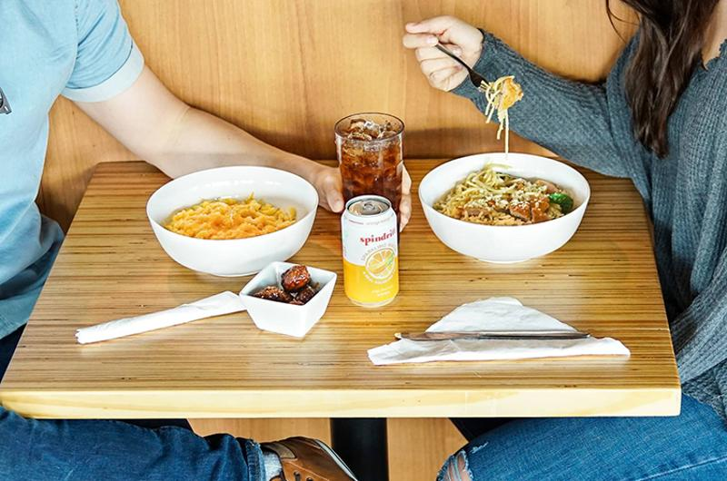noodles company couple table food