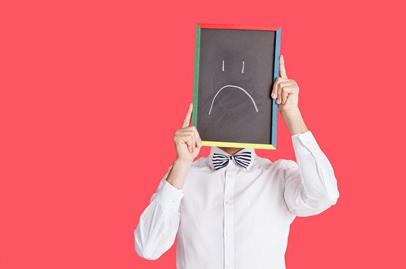 sad smiley sign