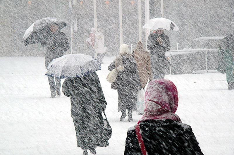 snow storm people walking