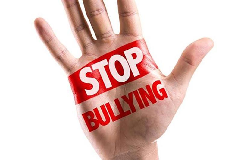 stop bullying hand red
