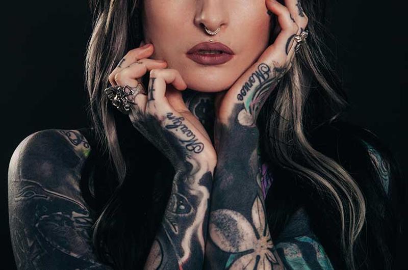 tattoo woman piercings
