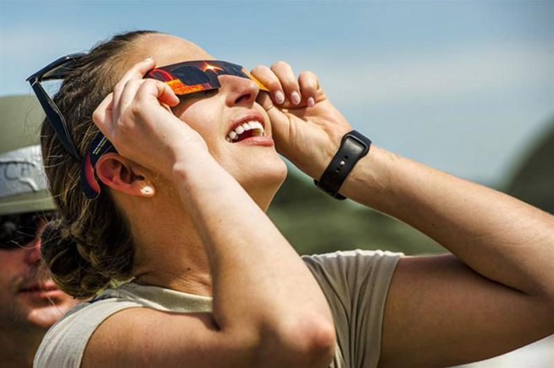 woman eclipse glasses
