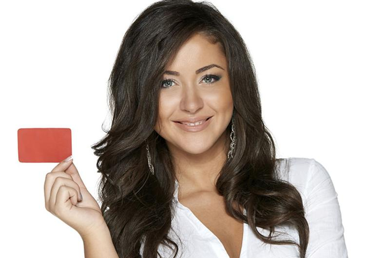 woman holding loyalty card