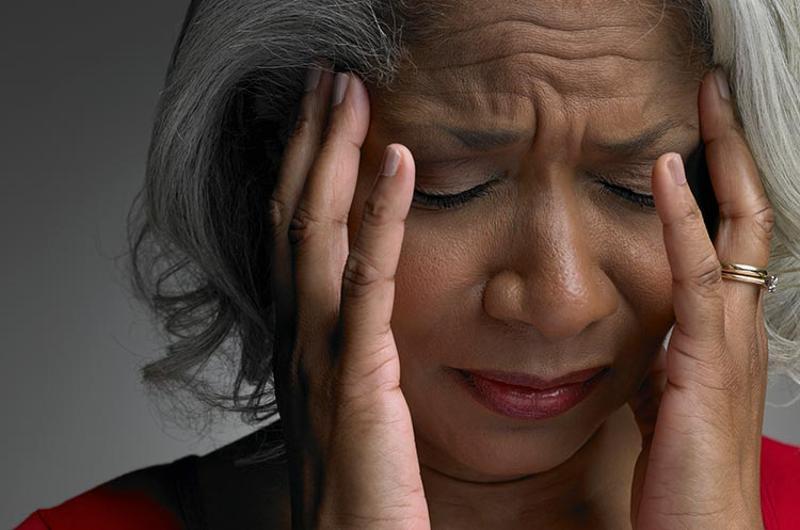 woman ouch headache