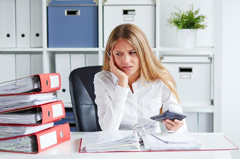 woman paperwork binders