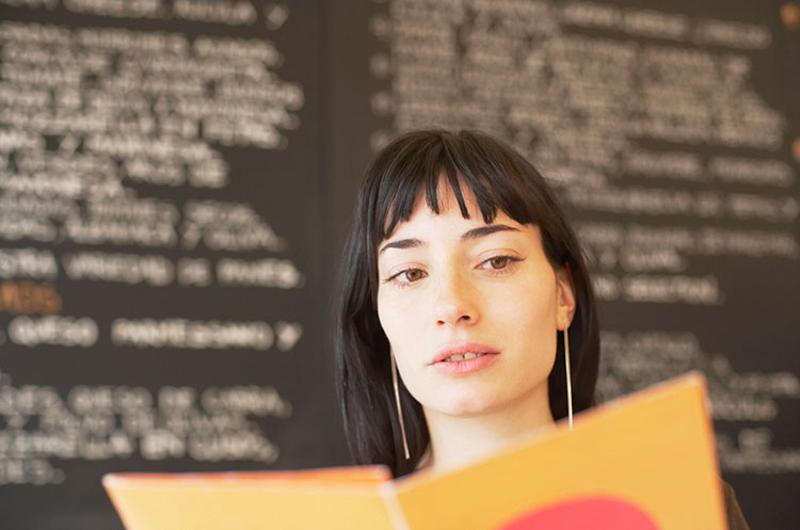 woman reading menu