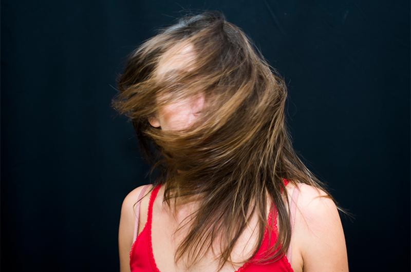 woman turning head
