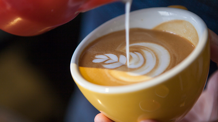 pouring latte art specialty coffee