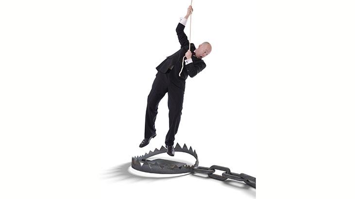 businessman danging rope bear trap