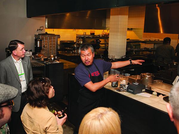 Chef Bill Kim shows open kitchen at BellyQ