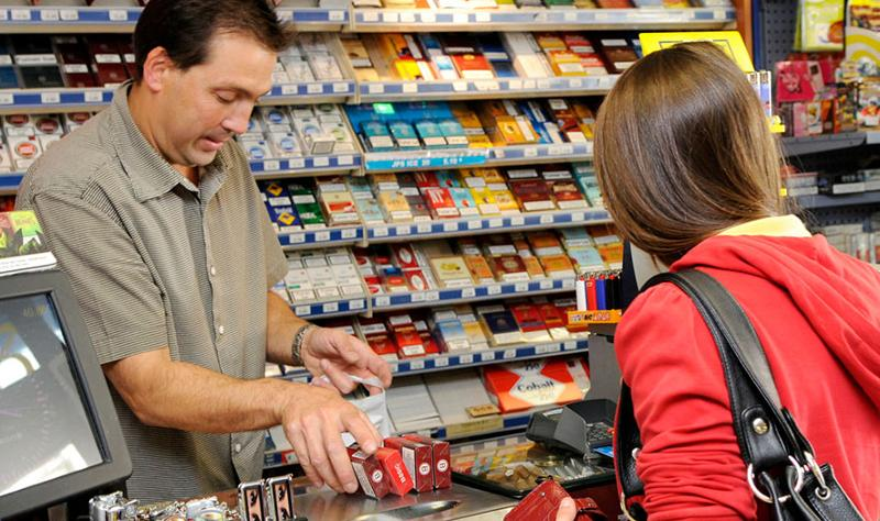 Young lady buying cigarettes