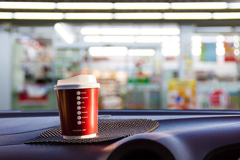 coffee cup on dashboard