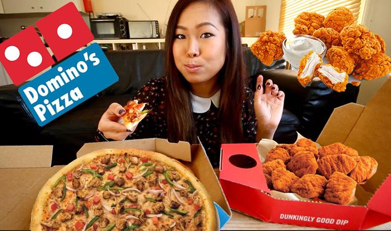 Lady eating Domino's Pizza