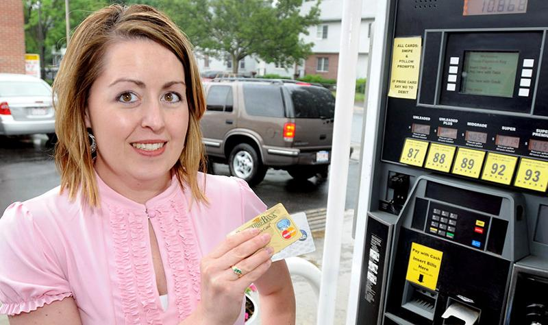 Lady at gas pumps