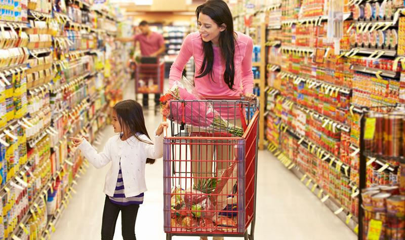 hispanic mother and daughter shopping