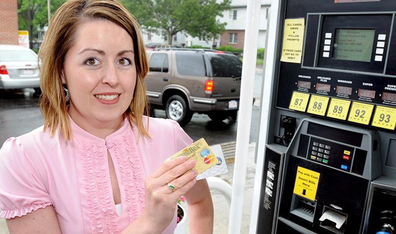 Lady at gas pump