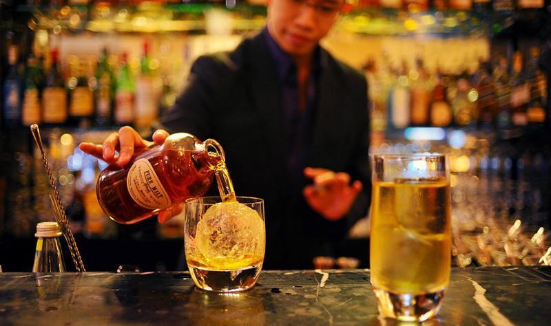 Man pouring whiskey