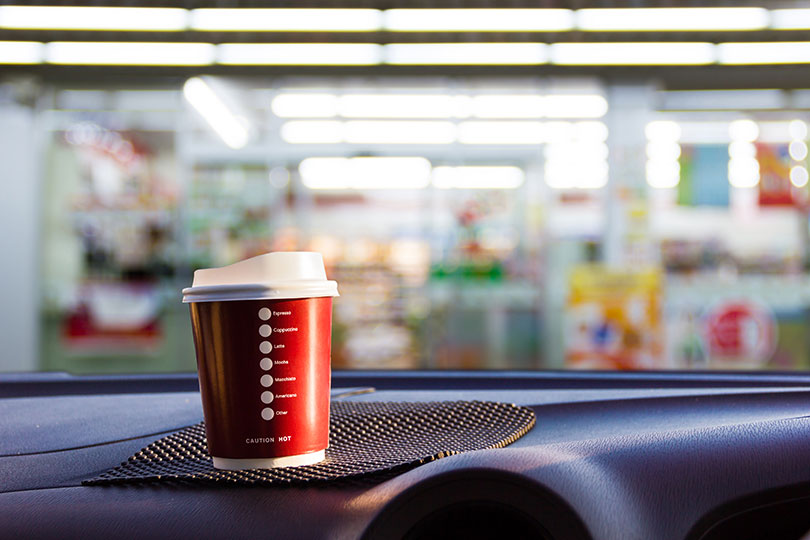 coffee cup on dashboard