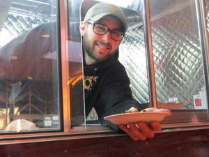 Serving up hot food from the One Eighy Q food truck at Convenience Retailing University