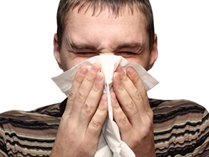man sneeze kleenex