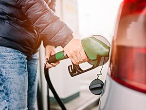 gas pump woman refueling