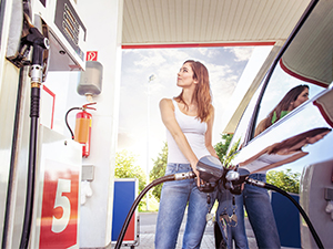 young woman refueling