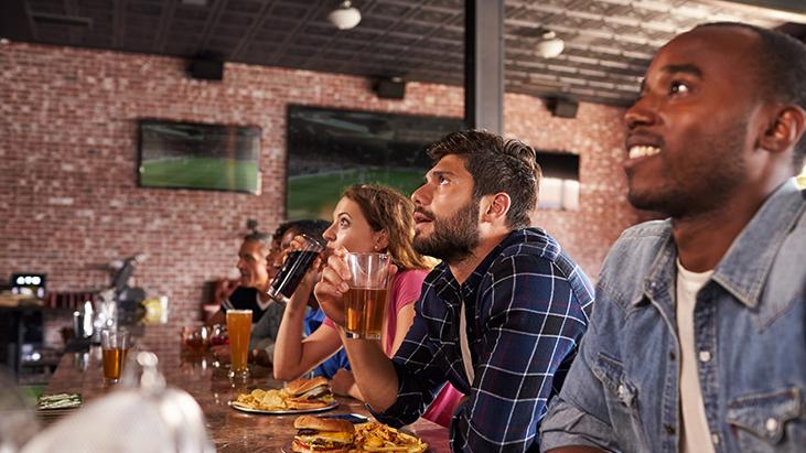 customers watching TV at bar