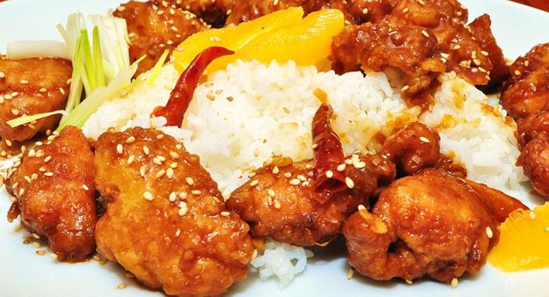 Orange Sesame Chicken with Steamed Rice and Vegetable Stir-Fry