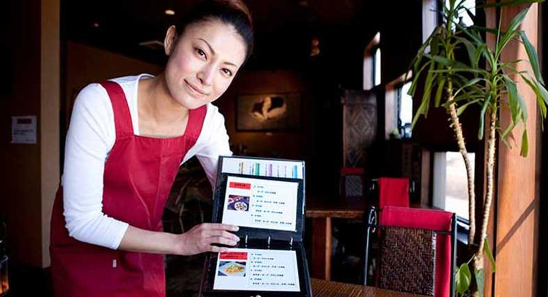 woman showing menu