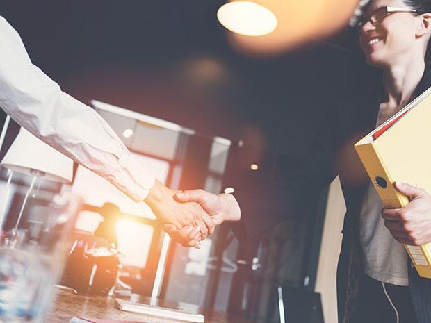 millennial employee handshake