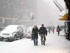 people walking blizzard street