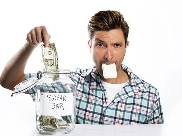 man paying swear jar