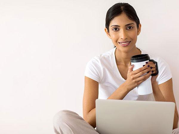 smiling morning coffee laptop