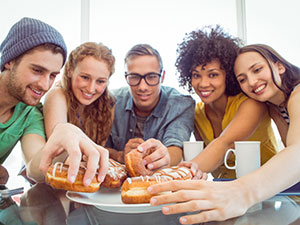 college students taste testing foods