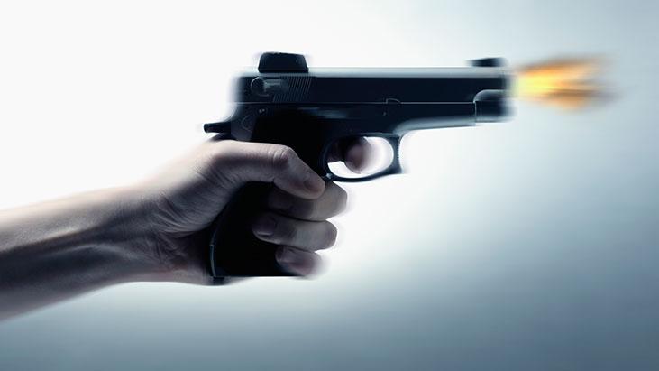 hand firing gun shooting