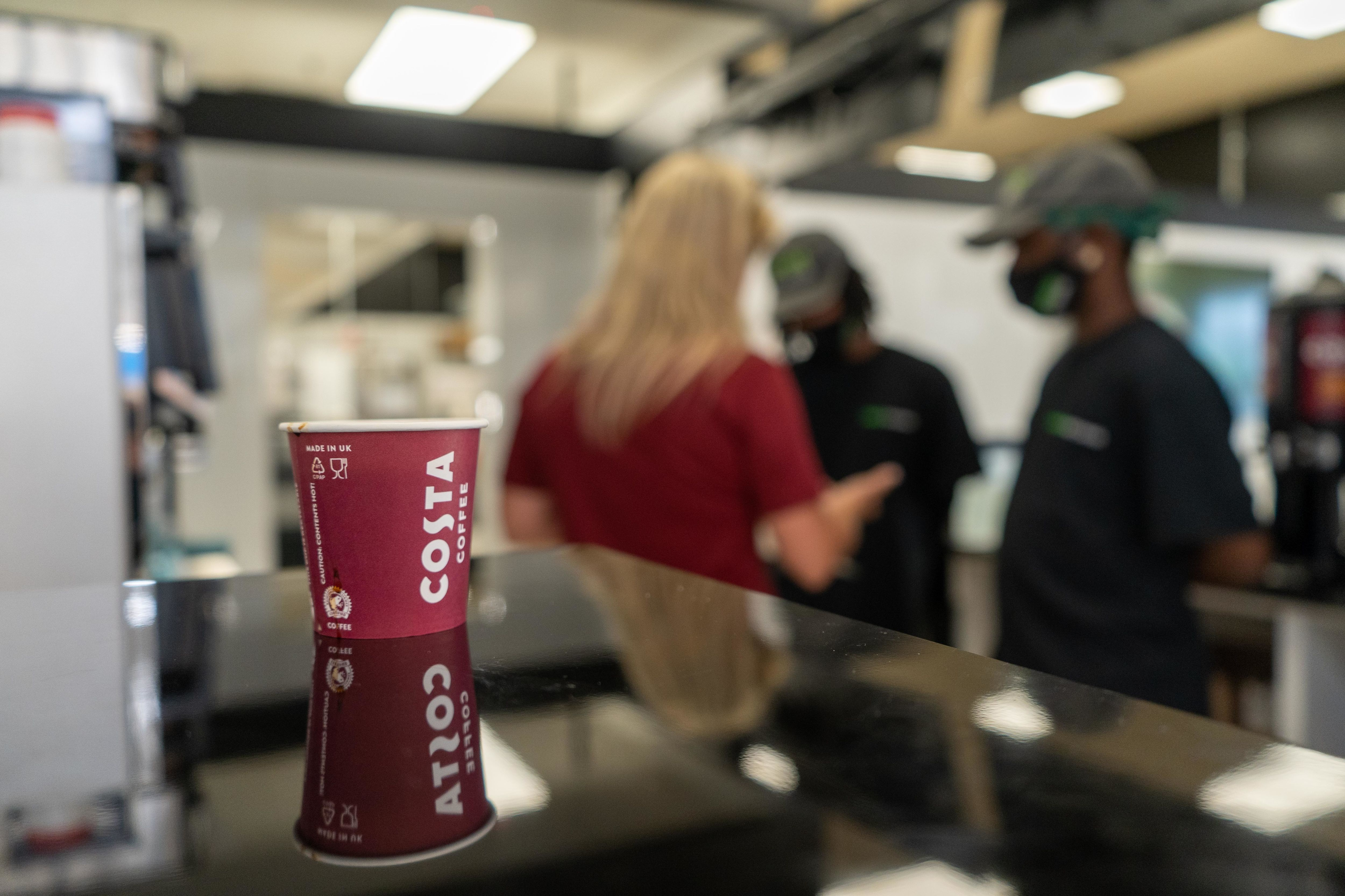 Costa Coffee cup and employees