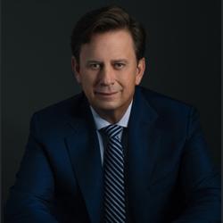 Headshot of Swisher President and CEO John Miller