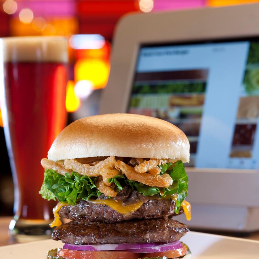 stacked burger and iPad