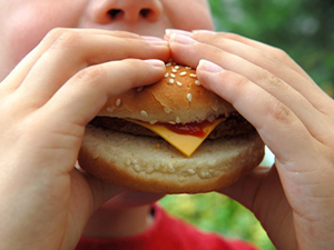 fast food kid eating cheeseburger